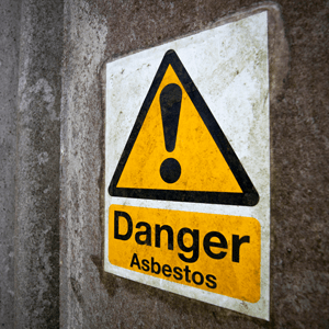 Asbestos warning sign - yellow triangle with black exclamation mark